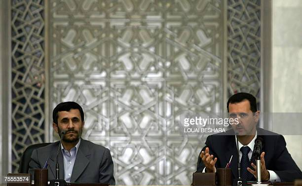 Syrian President Bashar al-Assad gestures during his joint press conference with his Iranian counterpart Mahmoud Ahmadinejad at the Syrian al-Shaab...
