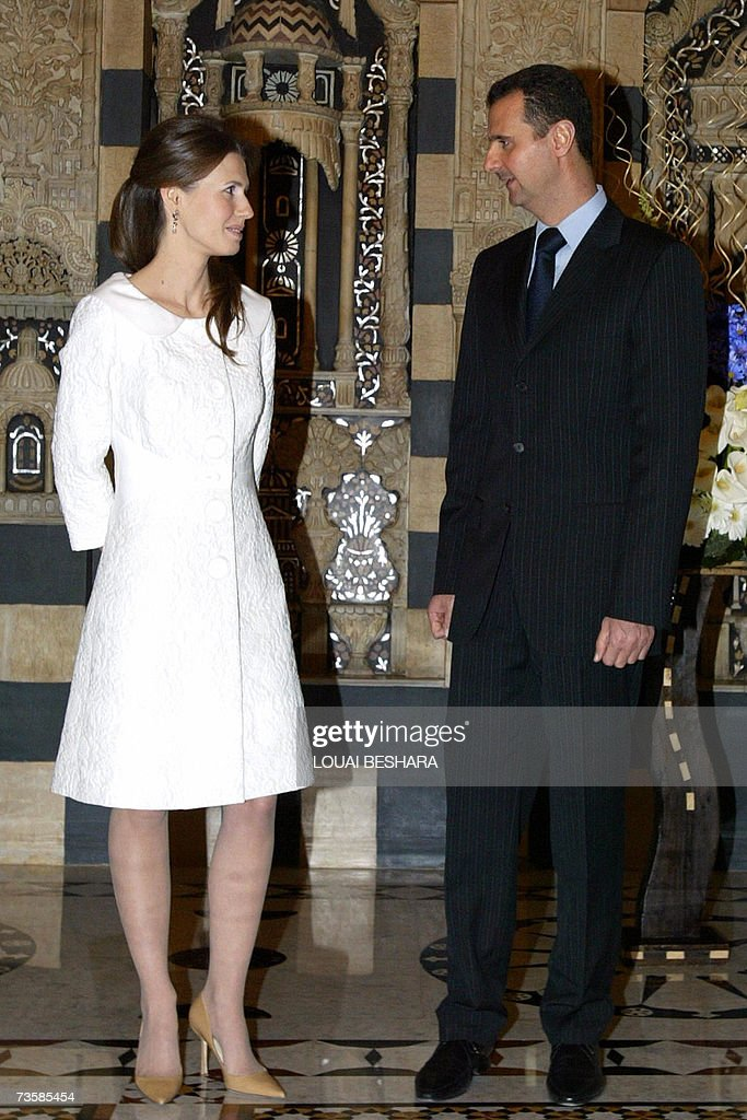 Syrian President Bashar Al Ad Speaks With His Wife Asma During A Reception For Teacher S