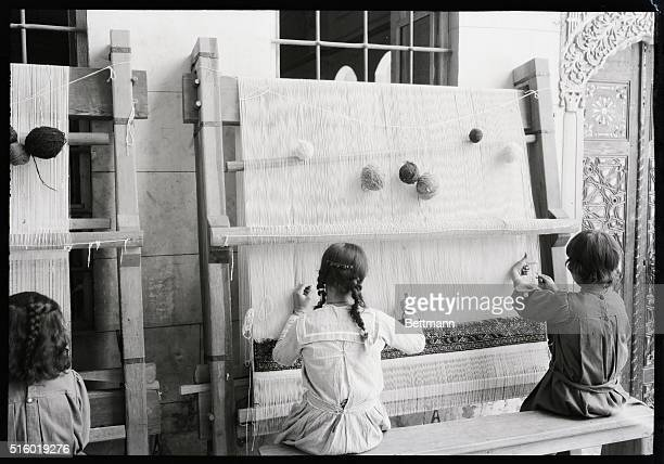 Young girls at looms in a small rug factory in Damascus Syria Undated photograph BPA