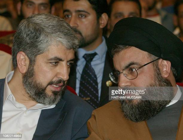 Damascusbased Hamas political supremo Khaled Meshaal talks to Hezbollah's Secretary General Sheikh Hassan Nassrallah in Beirut as they attended a...