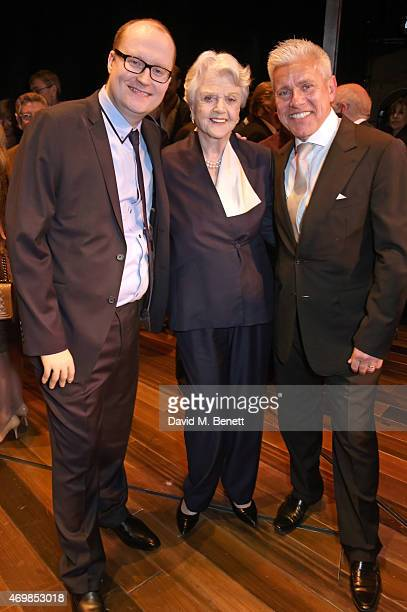 Dame Angela Lansbury poses with producers Michael Harrison and David Ian at a post show drinks reception on stage following the press night...