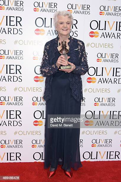 Dame Angela Lansbury winner of the Best Actress in a Supporting Role for Blithe Spirit poses in the winners room at The Olivier Awards at The Royal...