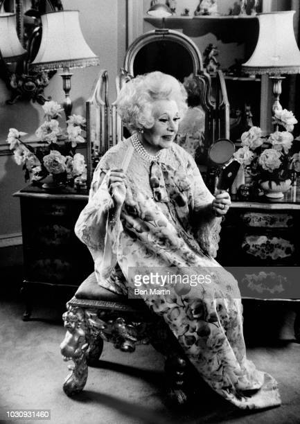 Dame Barbara Cartland English author of romance novels and stepgrandmother of Princess Diana, at her dressing table, September 19th, 1977.
