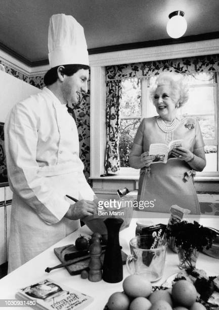 Dame Barbara Cartland English author of romance novels and stepgrandmother of Princess Diana, consulting with her chef, September 19th, 1977.