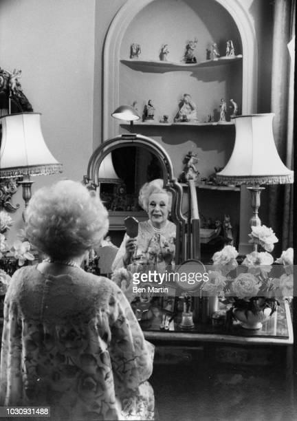 Dame Barbara Cartland English author of romance novels, at her dressing table in the boudoir of her home in Camfield Place, Hertfordshire, September...