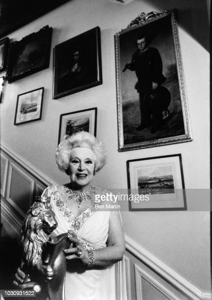 Dame Barbara Cartland English author of romance novels, on the staircase of her home in Camfield Place, Hertfordshire, September 19th, 1977.