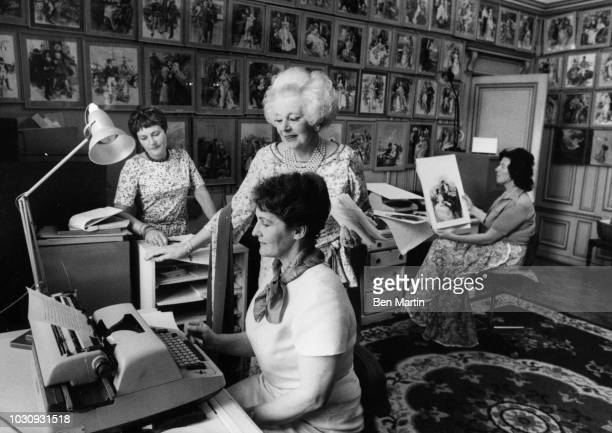 Dame Barbara Cartland English author of romance novels, working with her assistants at home in Camfield Place, Hertfordshire, September 19th, 1977.