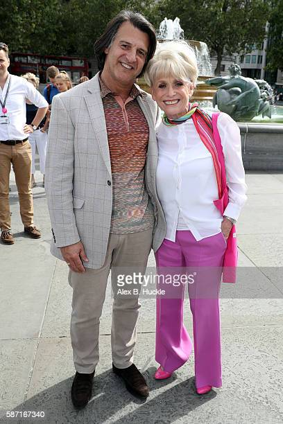 Dame Barbara Windsor and Scott Mitchell attend a photo call in Trafalgar Square where she joined Mayor's Team ambassadors to show London is open to...