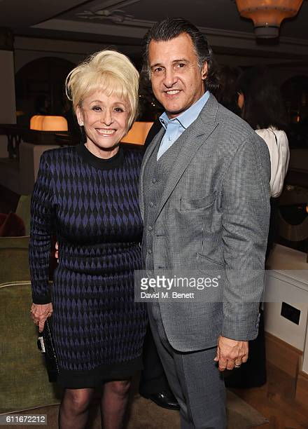 Dame Barbara Windsor and Scott Mitchell attend an after party following Dame Joan Collins' one woman show 'Joan Collins Unscripted' at the Cafe Royal...