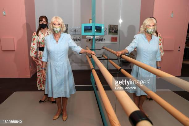 Dame Darcey Bussell, President of the Royal Academy of Dance and Camilla, Duchess of Cornwall pose next to a Ballet barre during a visit to 'On...