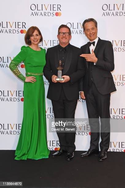 Dame Darcey Bussell Sir Matthew Bourne winner of the Special Award and Richard E Grant pose in the press room at The Olivier Awards 2019 with...