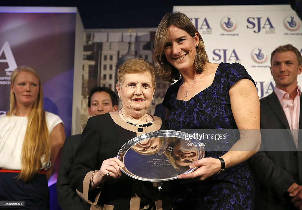 Dame Diana Elling receives the JL Manning trophy from Katherine Grainger during the SJA British Sports Awards at Tower of London on December 12, 2013 in London, England.