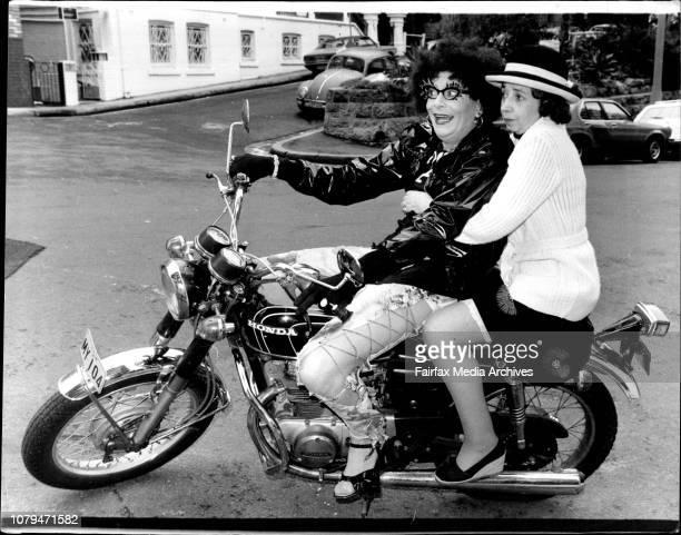 Dame Edna Everage arrived at the Sebel Town House Elizabeth Baytoday dressed as Edna Evil in punk gear on her motor bike with her bridesmaid Madge...