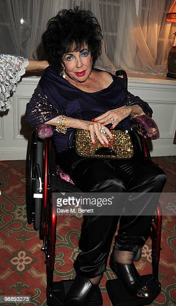 Dame Elizabeth Taylor poses backstage following 'Priscilla Queen Of The Desert' at the Palace Theatre on May 6 2010 in London England