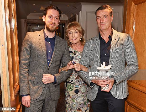 Dame Gillian Lynne poses with choreographer Jonathan Watkins and artistic director David Nixon accepting the Dance award for 1984 with the Northern...