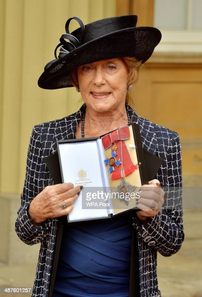 Dame Gillian Lynne poses with her Dame Commander of the Order of the British Empire for services to dance and musical theatre after she was awarded...