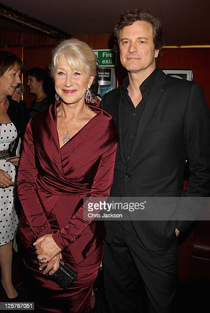 Dame Helen Mirren and actor Colin Firth arrive at the UK premiere of The Debt at The Curzon Mayfair on September 21, 2011 in London, England. The...