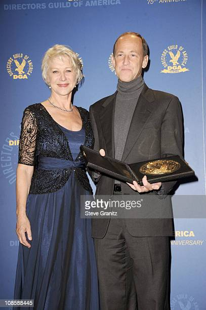 Dame Helen Mirren and director Charles Ferguson pose in the press room during the 63rd Annual DGA Awards held at the Grand Ballroom at Hollywood &...