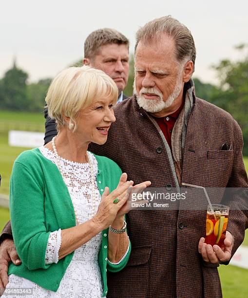 Dame Helen Mirren and Taylor Hackford attend day one of the Audi Polo Challenge at Coworth Park Polo Club on May 31 2014 in Ascot England