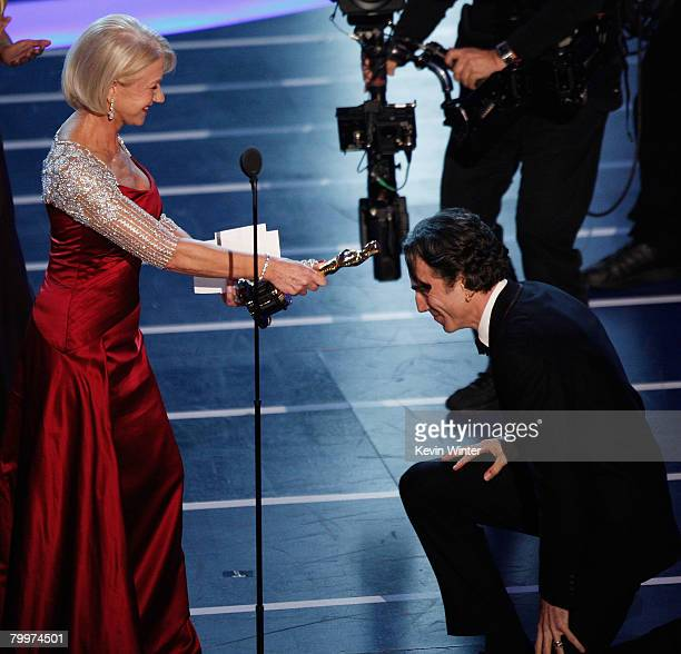 TELECAST*** Dame Helen Mirren presents actor Daniel DayLewis with the award for Best Actor in a Leading Role for the film 'There Will Be Blood'...