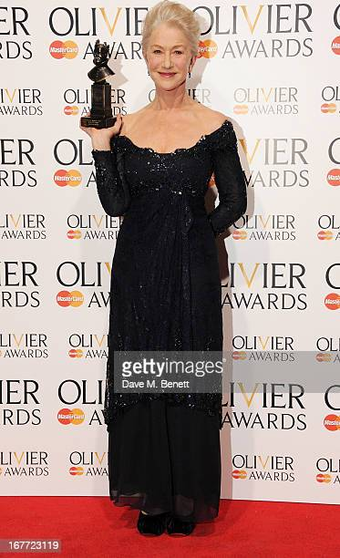 Dame Helen Mirren, winner of the Best Actress award, poses in the press room at The Laurence Olivier Awards 2013 at The Royal Opera House on April...