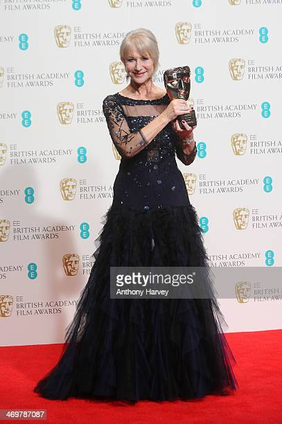Dame Helen Mirren winner of the Fellowship award poses in the winners room at the EE British Academy Film Awards 2014 at The Royal Opera House on...