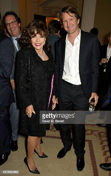 Dame Joan Collins and director Tom Hooper attend The Academy Of Motion Pictures Arts Sciences new members reception hosted by Ambassador Matthew...