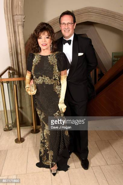 Dame Joan Collins and Percy Gibson attend the BFI Luminous Fundraising Gala at The Guildhall on October 3 2017 in London England