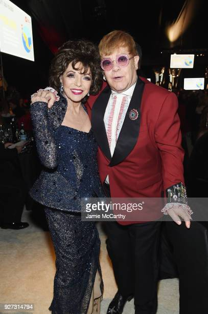 Dame Joan Collins and Sir Elton John attend the 26th annual Elton John AIDS Foundation Academy Awards Viewing Party sponsored by Bulgari celebrating...