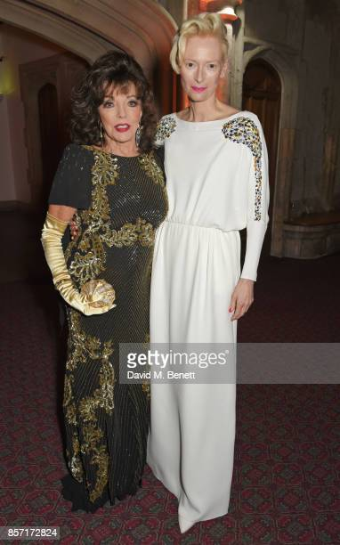 Dame Joan Collins and Tilda Swinton attend the BFI and IWC Luminous Gala at The Guildhall on October 3 2017 in London England