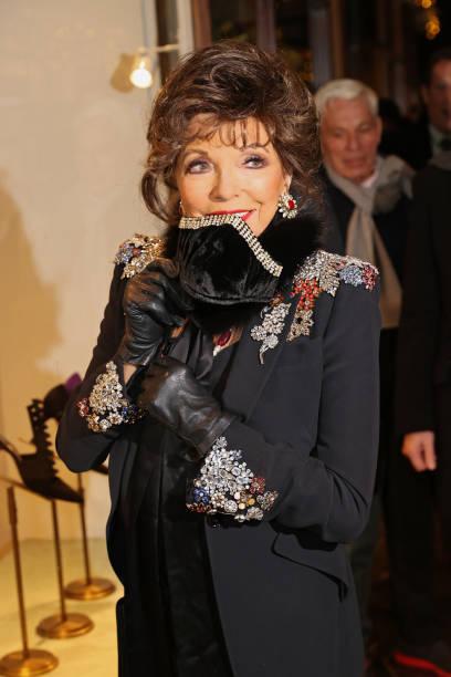 GBR: Dame Joan Collins Turns On The Burlington Arcade Christmas Lights