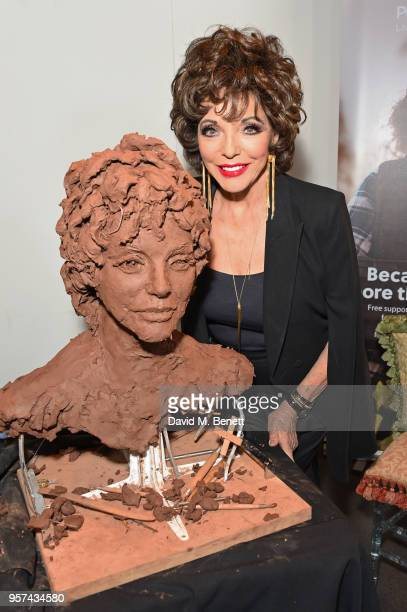 Dame Joan Collins poses at a live sculpting in support of Penny Brohn UK Charity at the London Film Museum on May 11 2018 in London England