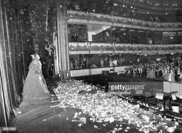 Dame Joan Sutherland the Australian soprano singer being showered with flowers on stage at Covent Garden