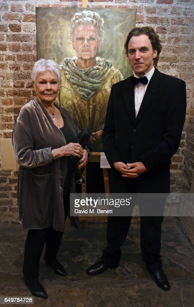 Dame Judi Dench and Alexander Newley attend the St MartinintheFields Gala Dinner and auction of Alexander Newley portraits on March 8 2017 in London...