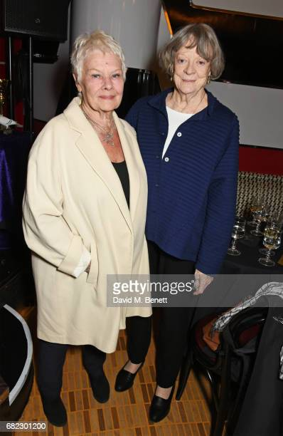 Dame Judi Dench and Dame Maggie Smith attend the Acting For Others Presidential Awards at The Crazy Coqs on May 12 2017 in London England