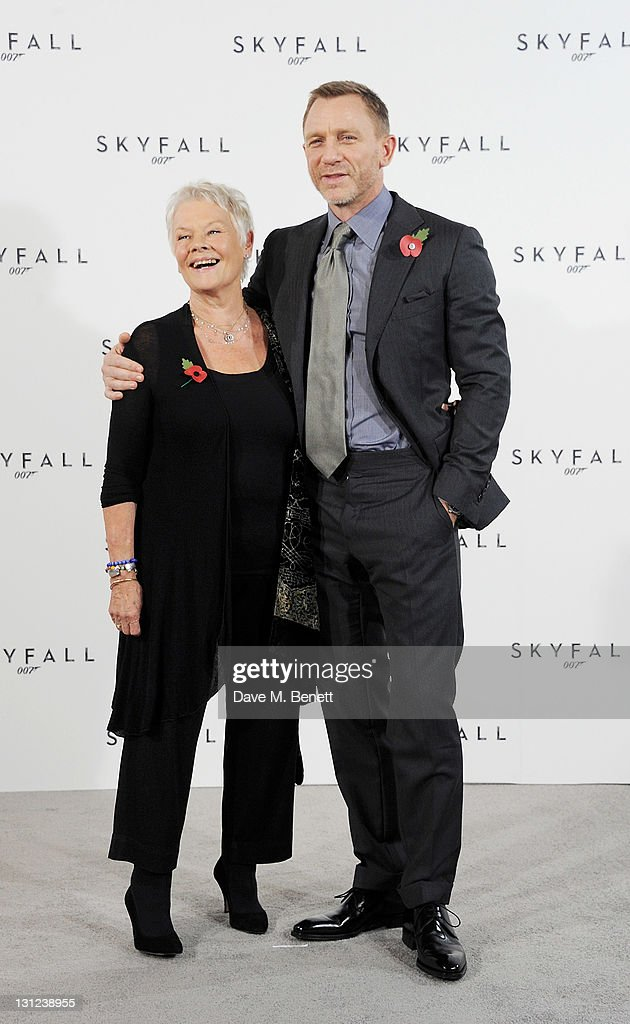 Dame Judi Dench (L) and Daniel Craig attend a photocall with cast and filmmakers to mark the start of production which is due to commence on the 23rd Bond Film and announce the title of the film as 'Skyfall' at Massimo Restaurant & Oyster Bar on November 3, 2011 in London, United Kingdom.
