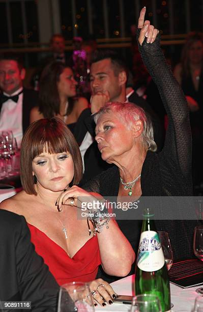 Dame Judi Dench and daughter Finty Williams attend the Collars and Cuffs Ball at the Royal Opera House on September 17 2009 in London England