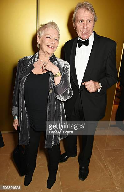 Dame Judi Dench and David Mills arrive at The London Critics' Circle Film Awards at The May Fair Hotel on January 17 2016 in London England