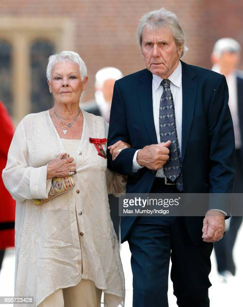 Dame Judi Dench and David Mills arrive to attend Evensong at the Chapel Royal Hampton Court Palace to celebrate the Centenary of the founding of the...