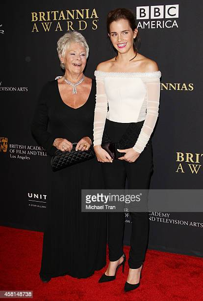 Dame Judi Dench and Emma Watson arrive at the BAFTA Los Angeles Jaguar Britannia Awards held at The Beverly Hilton Hotel on October 30, 2014 in...