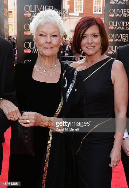 Dame Judi Dench and Finty Williams attend the Laurence Olivier Awards at The Royal Opera House on April 13 2014 in London England