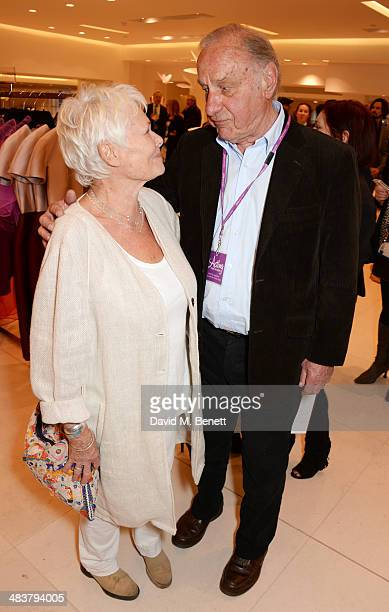 Dame Judi Dench and Geoffrey Palmer attend the Shop with the Stars a public shopping evening to celebrate The Olivier Awards with MasterCard to raise...
