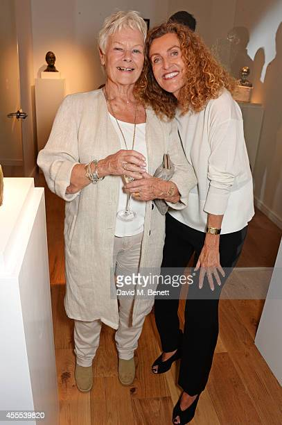 Dame Judi Dench and Nicole Farhi attend a private view for Nicole Farhi's debut exhibition of sculptures 'From The Neck Up' at Bowman Sculpture on...
