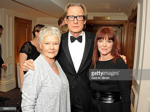 Dame Judi Dench Bill Nighy and Finty Williams attend a drinks reception at the 58th London Evening Standard Theatre Awards in association with...