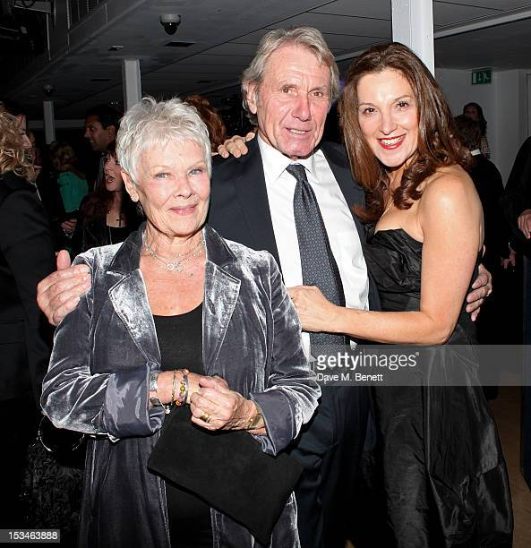Dame Judi Dench David Mills and Barbara Broccoli attend '50 Years Of James Bond The Auction' celebrating the 50th anniversary of the film franchise...