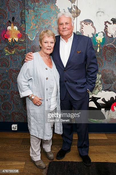 Dame Judi Dench poses with Sir Richard Eyre following an 'In Conversation' at The Hospital Club as part of the Mountview Academy's 70th birthday...