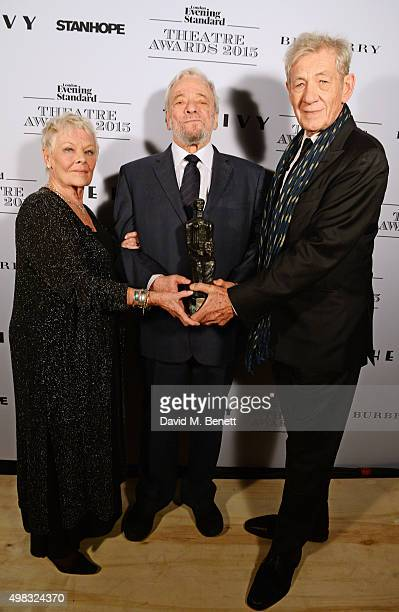 Dame Judi Dench Stephen Sondheim winner of the Lebedev Award and Sir Ian McKellen pose in front of the Winners Boards at The London Evening Standard...