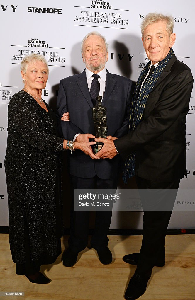 Dame Judi Dench, Stephen Sondheim, winner of the Lebedev Award, and Sir Ian McKellen pose in front of the Winners Boards at The London Evening Standard Theatre Awards in partnership with The Ivy at The Old Vic Theatre on November 22, 2015 in London, England.