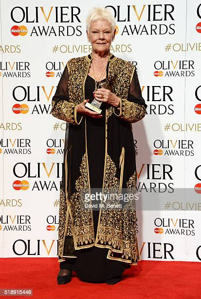Dame Judi Dench winner of the Best Actress In A Supporting Role award for 'The Winter's Tale' poses in the Winners Room at The Olivier Awards with...