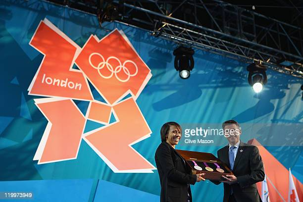 Dame Kelly Holmes and LOCOG Chairman Sebastian Coe present the olympic medals during the' London 2012 One Year To Go' ceremony in Trafalgar Square on...